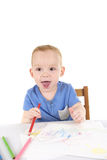 Little boy is drawing the picture Royalty Free Stock Images