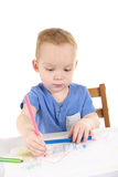 Little boy is drawing the picture Royalty Free Stock Photo