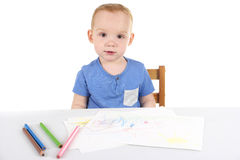 Little boy is drawing the picture Stock Image