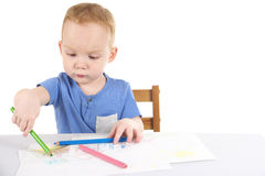 Little boy is drawing the picture Royalty Free Stock Photos