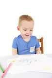 Little boy is drawing the picture Stock Photo