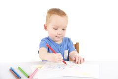 Little boy is drawing the picture Stock Photography