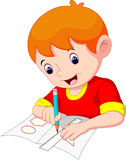 Little boy drawing on a piece of paper Stock Photography