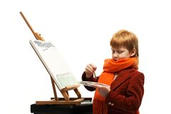 Little boy drawing Stock Images