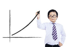 Little boy drawing statistic arrow. On screen with a pen Royalty Free Stock Photos