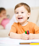 Little boy is drawing on white paper Royalty Free Stock Image