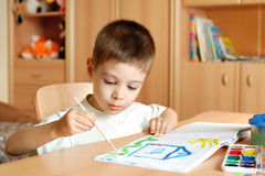Little boy draws Royalty Free Stock Images