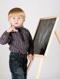 Little boy draws on blackboard Royalty Free Stock Photos