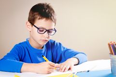 Little boy draws with color pencils and felt pens Royalty Free Stock Images