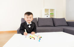 Little boy draws with color pencils Stock Photography