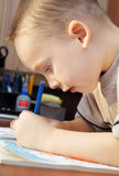 Little boy draws with colorful pencils Stock Photo