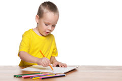Little boy draws at the desk Royalty Free Stock Photography