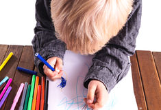 Little boy draws a drawing Stock Photo