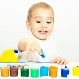 Little boy draws fingers with paint Royalty Free Stock Images