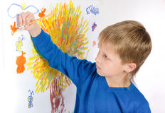 Little boy draws a picture Stock Photo
