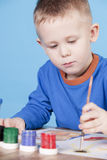 Little boy draws pictures Stock Images