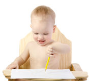 Little boy draws the sun Royalty Free Stock Images
