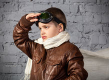 Little boy dreaming of becoming a pilot. In retro style uniform Stock Image