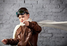 Little boy dreaming of becoming a pilot. In retro style uniform Royalty Free Stock Photography