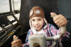Little boy dreaming of being pilot Stock Photos