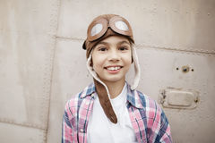 Little boy dreaming of being pilot Stock Images