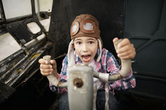 Little boy dreaming of being pilot Stock Photo