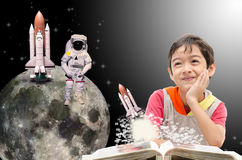 Little boy dreaming  about his future out of space. Dark Royalty Free Stock Photo
