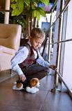 Little boy with puppy toy Stock Photos