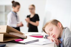 Little boy dreaming on table. Children in business concept Royalty Free Stock Photography