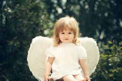 Little boy dressed as angel Stock Photo