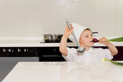 Little boy dressed as a chef playing Royalty Free Stock Image