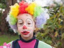 Little boy dressed as clown stock photos