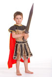 Little boy dressed as a knight. The little boy dressed as a knight holding both hands a toy sword, isolated on white background Stock Photography