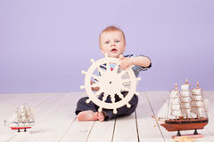 A little boy dressed as a sailor captain of ship Stock Photo
