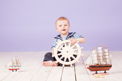 A little boy dressed as a sailor captain of ship Stock Images