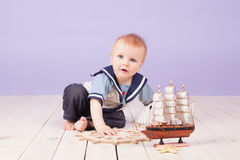 A little boy dressed as a sailor captain of ship Stock Photography