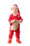 A little boy dressed as Santa Claus. Royalty Free Stock Photo