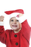 Little boy dressed as Santa Claus, and telephoning Royalty Free Stock Images