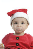 Little boy dressed as Santa Claus, and telephoning Stock Photography