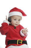 Little boy dressed as Santa Claus, and telephoning Royalty Free Stock Image