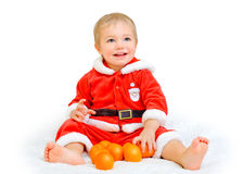 Little boy dressed as Santa Claus Stock Images