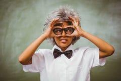 Little boy dressed as senior teacher Stock Image