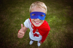 Little boy dressed as superman Stock Image