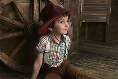 Little boy dressed in cowboy sitting Royalty Free Stock Photography