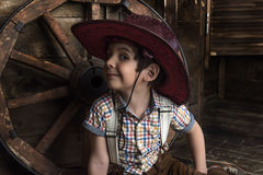 Little boy dressed in cowboy sitting Royalty Free Stock Images