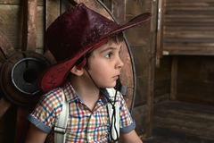 Little boy dressed in cowboy sitting Royalty Free Stock Image