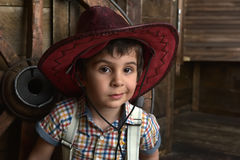 Little boy dressed in cowboy sitting Royalty Free Stock Photo