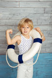 Little boy dressed lifeline. And shows its strength Royalty Free Stock Photography
