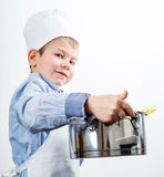 Little boy dressed like a chef Stock Photos