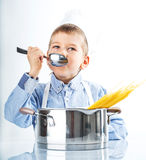 Little boy dressed like a chef Royalty Free Stock Photos